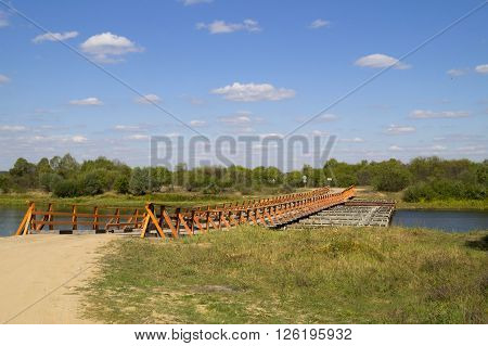 Prefabricated temporary crossing of the river summer day
