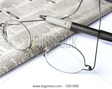 Glasses, Pen, And Newspaper