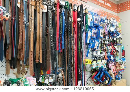 Moscow, Russia - April 16.2016. Leashes and collars in a Four paws pet store