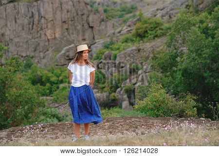 Happy Girl Standing On A Background Of The Canyon