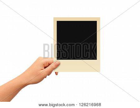 Hand holding photo frame isolated on white background