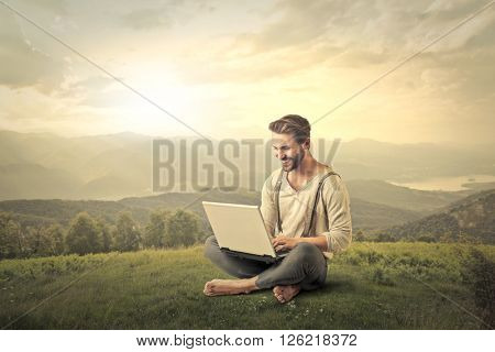 Handsome man using a pc