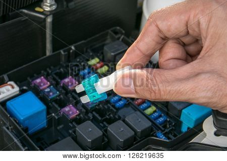 Auto mechanic checking a car fuse, mechanic, auto, fuse, closeup,