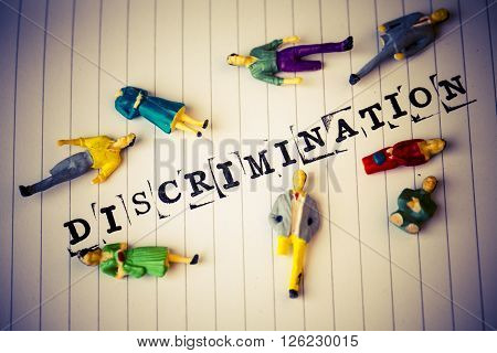 discrimination text on white paper with disabled people around