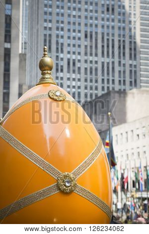 NEW YORK - MAR 27 2016: One of the giant Easter egg decorations at Rockefeller Center Channel Gardens off 5th Ave Easter Sunday at the traditional Easter Bonnet Parade in Manhattan on March 27, 2016.