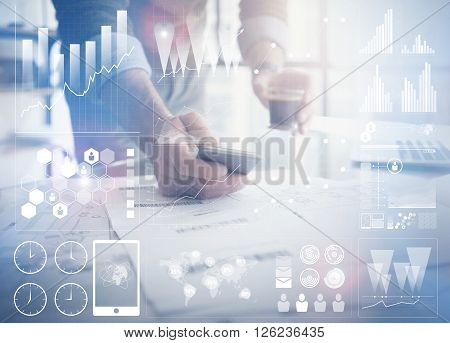 Business concept photo.Businessman working new startup project modern office.Holding contemporary smartphone hands. Worldwide connection technology, stock exchanges graphics interface.