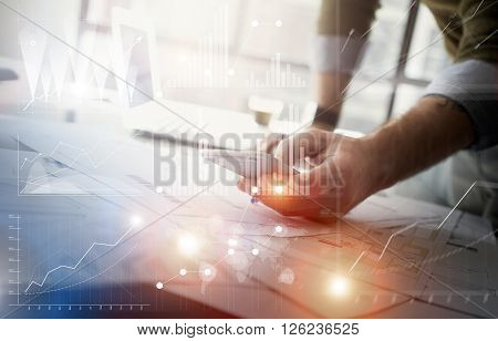 Business concept picture.Finance manager working new startup project modern office.Touching contemporary smartphone. Worldwide connection technology, stock exchanges graphics interface.