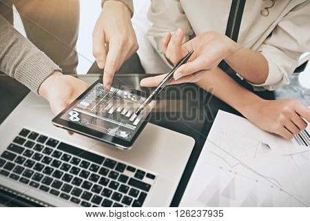 Investment department meeting process.Photo man showing reports modern tablet screen.Statistics graphics screen.Private banker manager holding pen for signs documents. New business project startup