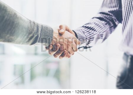Business partnership meeting concept. Image businessmans handshake. Successful businessmen handshaking after good deal. Horizontal, blurred