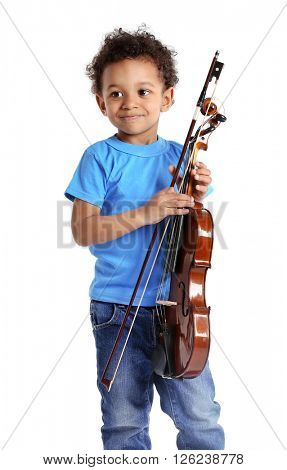 Little boy playing violin, isolated on white