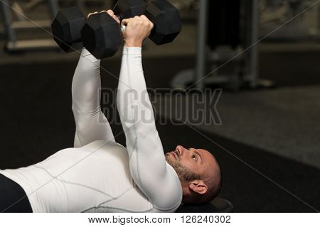 Young Healthy Man Doing Chest Exercise With Dumbbells