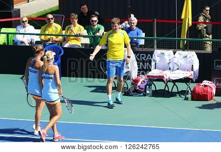 KYIV UKRAINE - APRIL 17 2016: Captain of Ukraine National Team Mikhail Filima (R) and players Kateryna Bondarenko and Olga Savchuk during BNP Paribas FedCup pair game Ukraine vs Argentina