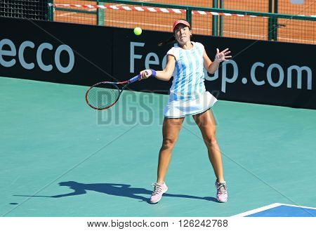KYIV UKRAINE - APRIL 17 2016: Guadalupe Perez Rojas of Argentina in action during BNP Paribas FedCup World Group II Play-off pair game against Ukraine at Campa Bucha Tennis Club in Kyiv Ukraine