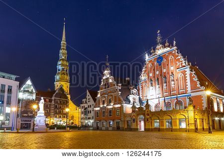 City Hall Square with House of the Blackheads and Saint Peter church in Old Town of Riga at night, Latvia