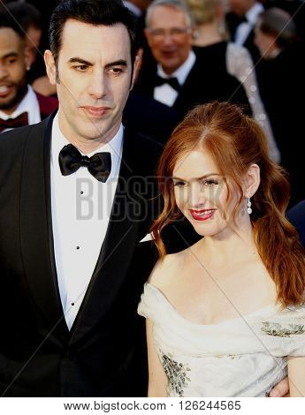 Sacha Baron Cohen and Isla Fisher at the 88th Annual Academy Awards held at the Dolby Theatre in Hollywood, USA on February 28, 2016.