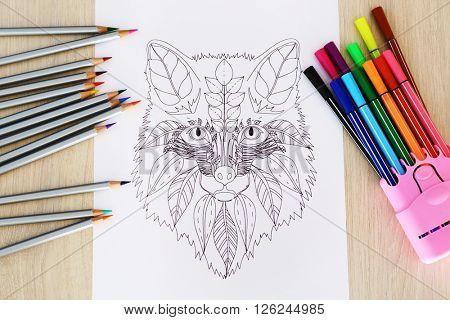 Adult anti stress coloring and soft tip pencils closeup