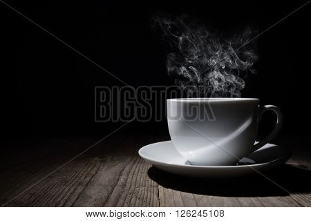 Hot cup of coffee or tea with steam and copy space