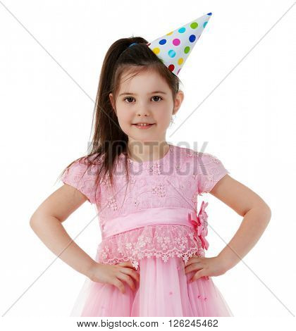 Little cute girl in birthday cap and pink dress, isolated on white