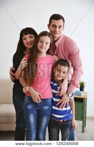 Portrait of happy family indoors