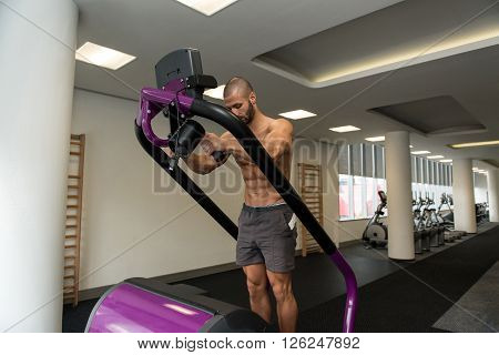 Young Man Exercising On A Stepper