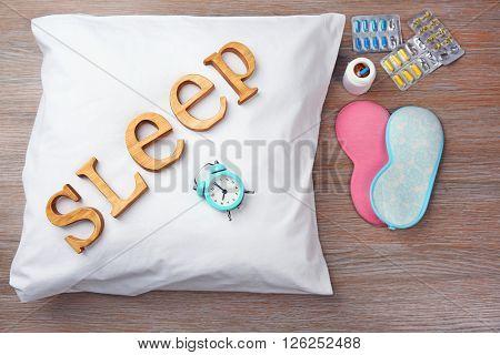 Word Sleep on a white pillow
