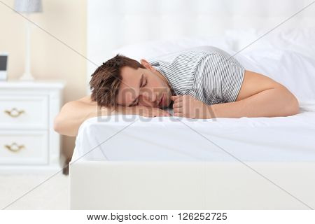 Man sleeping in the bed at home