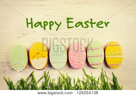 Delicious Easter cookies on wooden background. Retro stylization