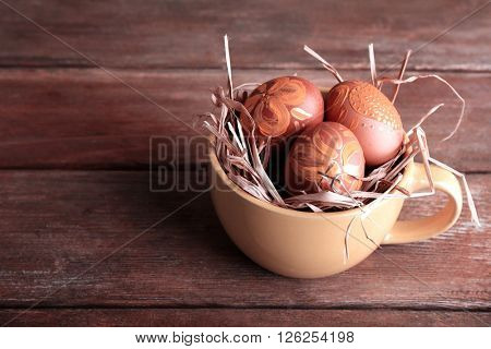 Easter eggs in mug on wooden background .Retro stylization