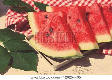 Slices of ripe watermelon on light table