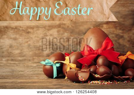 Chocolate Easter eggs on wooden background.Retro stylization