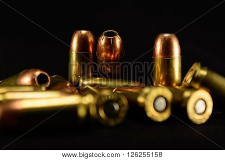 380 Auto bullets on black counter black background selective focus background