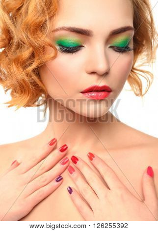 Beautiful girl with colorful makeup, manicure, close up