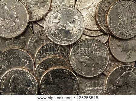 United States Coins quarters in a pile poverty riches savings thrift old and new state coins George Washington