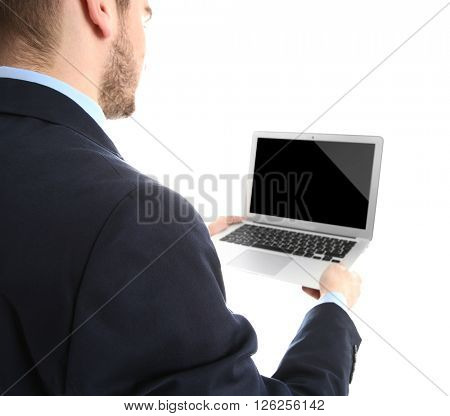 Young man in suit using laptop, isolated on white