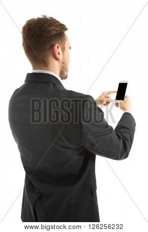 Young man in suit using mobile phone, isolated on white