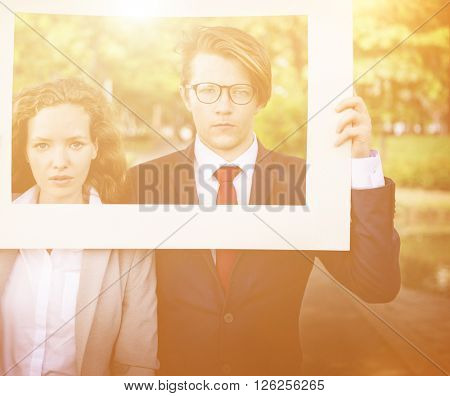 Business People Picture Frame Holding Concept