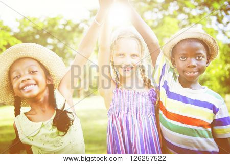 Children Outdoors Playing Cheerful Together Concept