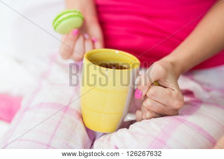 people and drinks concept - close up of young woman with tea cup