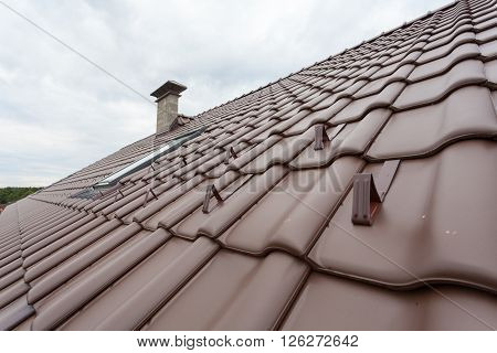 New roof with skylight natural red tile and chimney with snow stopers