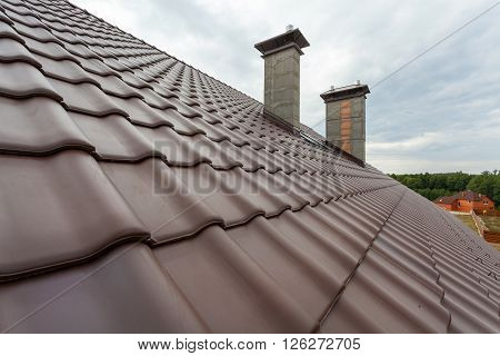 New roof with chimney natural red tile and chimney