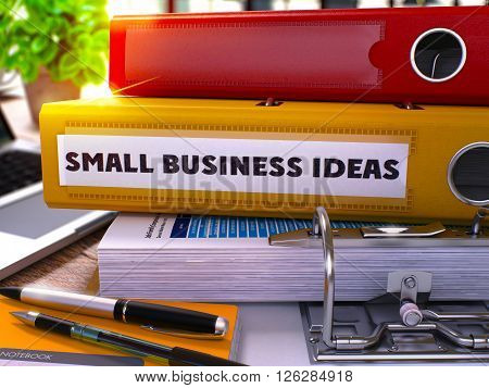 Small Business Ideas - Yellow Office Folder on Background of Working Table with Stationery and Laptop. Small Business Ideas Business Concept on Blurred Background. 3D.