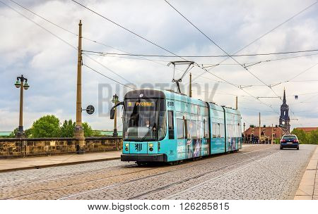 Dresden, Germany - May 04, 2014: City tram on Augustus bridge. Dresden is the capital of Saxony.