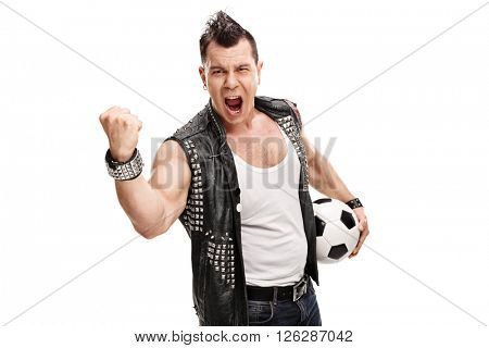 Studio shot of a football hooligan holding a ball and shouting isolated on white background