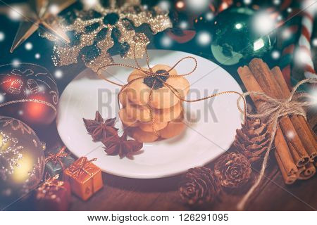selective focus of christmas cookies on the dish vintage toning