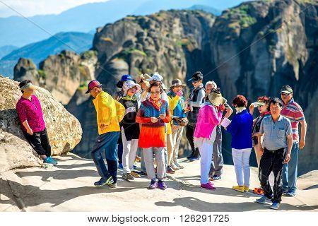 KALABAKA, GREECE - CIRCA JUNE 2015: Korean group of tourists visit Meteory monasteries in Kalabaka village in Greece
