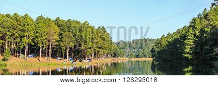 Dome tents beside the lake in camping site at Pang Ung (Pang Tong reservoir) Mae Hong Son province, Thailand, panorama view