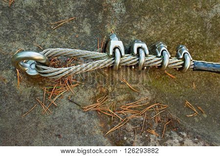 Mountain Wall With Carabine In The Sandstone Rock. End Of The Steel Rope In Loop.