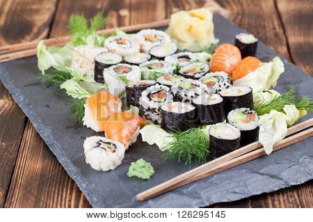 Sushi set on a slate board. Maki uramaki and nigiri sushi.