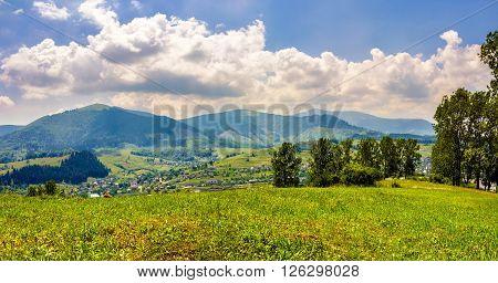 Meadow Near The Village In Mountain Valley
