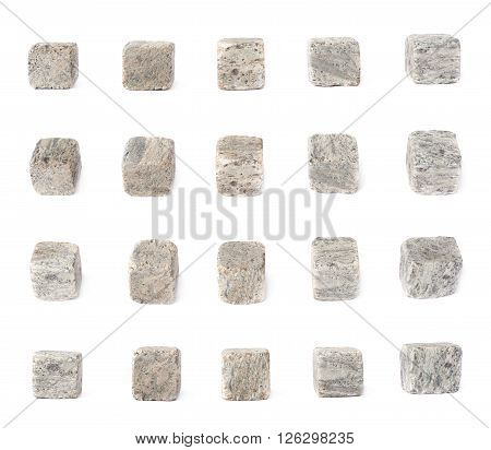 Set of five cooling whiskey granite stones isolated over the white background, each in four foreshortenings